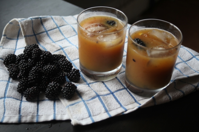 blackberries, orange juice, and Kraken Spiced Rum cocktail